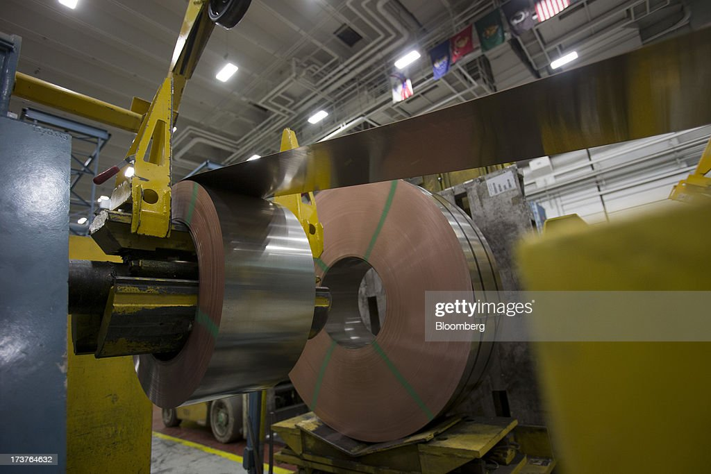 A coil of metal is fed through a machine to create coin-blanks at the U.S. Mint in Philadelphia, Pennsylvania, U.S., on Wednesday, July 17, 2013. Some sources of declining inflation 'are likely to be transitory' and expectations for future price increases 'have generally remained stable,' Ben S. Bernanke, chairman of the U.S. Federal Reserve said in prepared remarks. Photographer: Scott Eells/Bloomberg via Getty Images