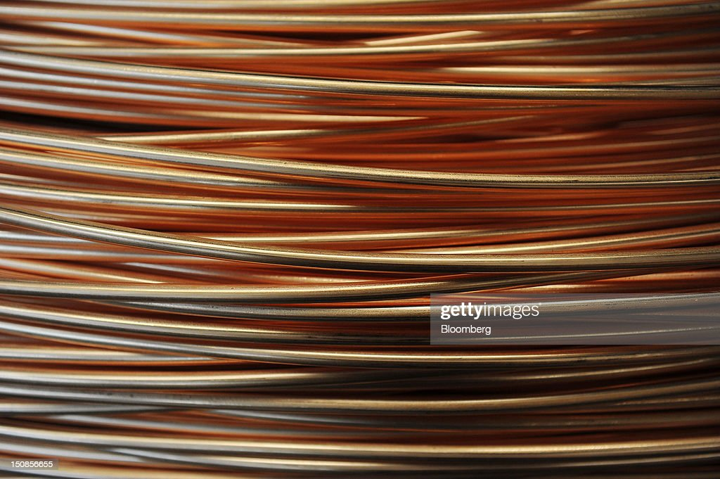 Coiled lengths of 8mm copper wire are seen before shipping in a warehouse at the copper mining and smelting complex, operated by RTB Bor Group, in Bor, Serbia, on Friday, Aug. 24, 2012. Copper neared a one-week low in London on signs Asian economies are slowing and speculation that U.S. policy makers will refrain from a fresh round of stimulus. Photographer: Oliver Bunic/Bloomberg via Getty Images