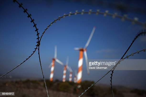 Coils of barbedwire protect visitors from wandering into the minefields that surround the wind farm on Mount Bnei Rasan overlooking the border with...