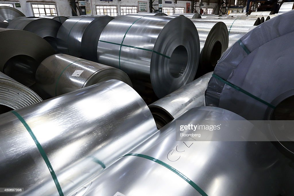 Coils of galvanized steel sit in a storage area at the manufacturing facility of Uttam Galva Steels Ltd the Indian unit of ArcelorMittal in Khopoli...