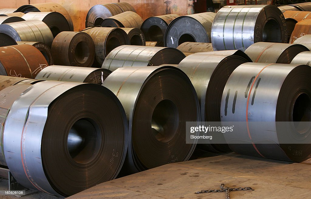 Coils of hot-rolled steel sit in the hot strip mill area of the PT Krakatau Steel plant in Cilegon, Banten province, Indonesia, on Thursday, Feb. 21, 2013. Krakatau Steel is Indonesia's biggest maker of the metal. Photographer: Dadang Tri/Bloomberg via Getty Images