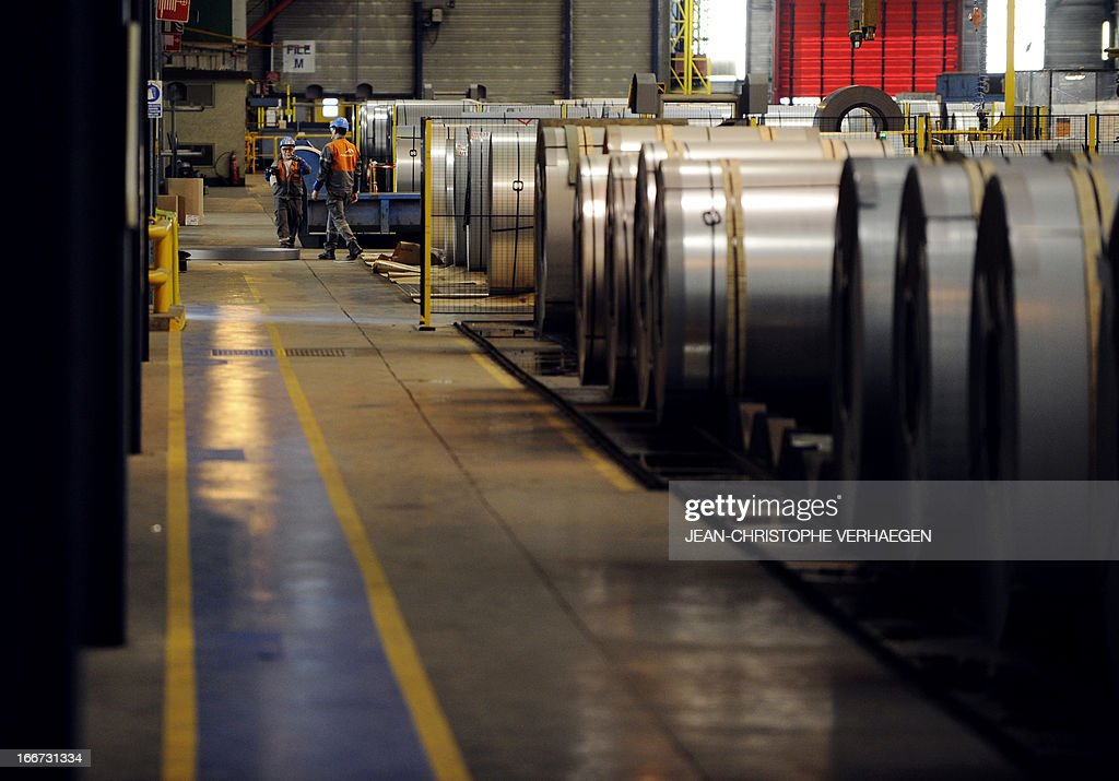 Coils of steel treated by galvanization are stored in the world's largest steel maker ArcelorMittal's 'cold factory' of the northeastern France plant of Florange, on April 16, 2013. Usibor steel (weight savings and improved crashworthiness) are producted in the cold factory. AFP PHOTO / JEAN-CHRISTOPHE VERHAEGEN