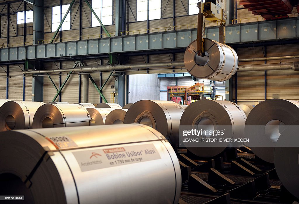 Coils of steel treated by galvanization are stored in the world's largest steel maker ArcelorMittal's 'cold factory' of the northeastern France plant of Florange, on April 16, 2013. Usibor steel (weight savings and improved crashworthiness) are producted in the cold factory.