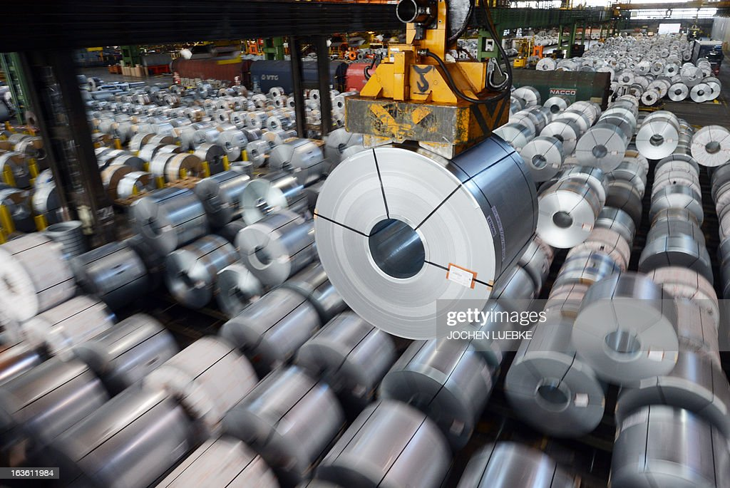 Coils of the Salzgitter AG are being maneuvered at the company's plant in Salzgitter, central Germany, on March 13, 2013. Salzgitter AG is Germany's number-two steel maker.