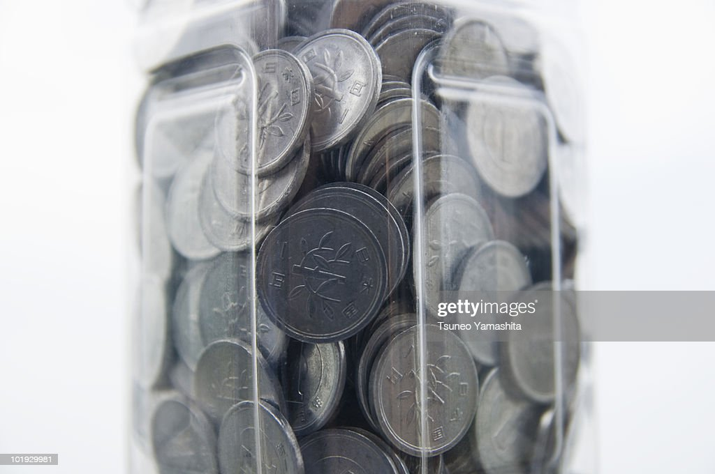 Coin in the bottle : Stock Photo