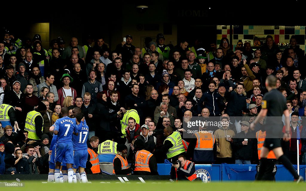A coin is thrown as Frank Lampard celebrates after scoring Chelsea's first goal during the Barclays Premier League match between Chelsea and West Ham United at Stamford Bridge on March 17, 2013 in London, England.
