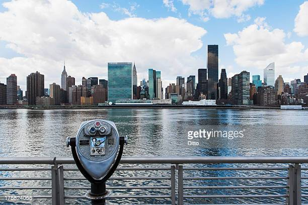 Coin operated binoculars and skyline of New York City