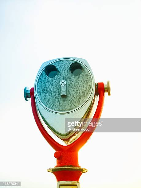 Coin operated binoculars with white background