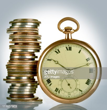 coin stack and pocket watch