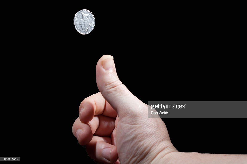 Coin toss : Stock Photo