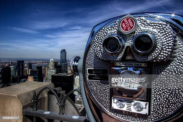 Coin-Operated Binocular With Skyscrapers In Background