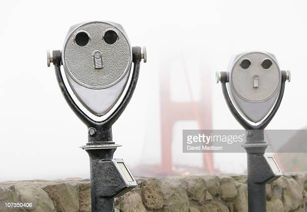 Coin-operated binoculars and Golden Gate Bridge.