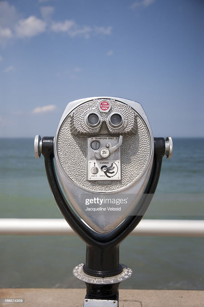 Coin-operated binoculars with ocean in background