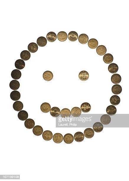 Coins arranged as smiley face