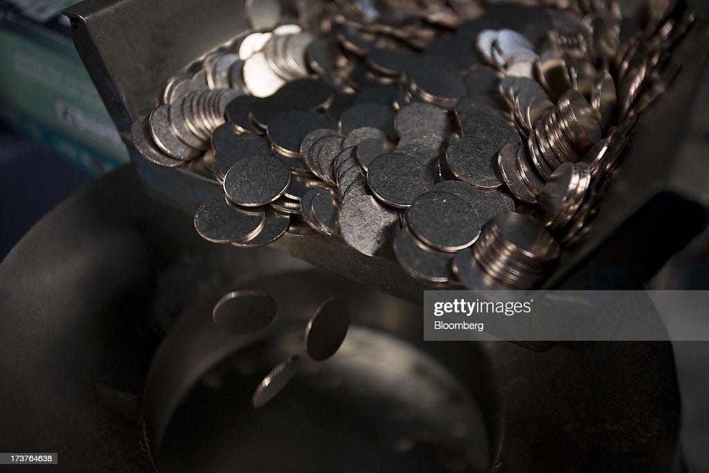 Coins blanks are fed into an upset mill at the U.S. Mint in Philadelphia, Pennsylvania, U.S., on Wednesday, July 17, 2013. Some sources of declining inflation 'are likely to be transitory' and expectations for future price increases 'have generally remained stable,' Ben S. Bernanke, chairman of the U.S. Federal Reserve said in prepared remarks. Photographer: Scott Eells/Bloomberg via Getty Images