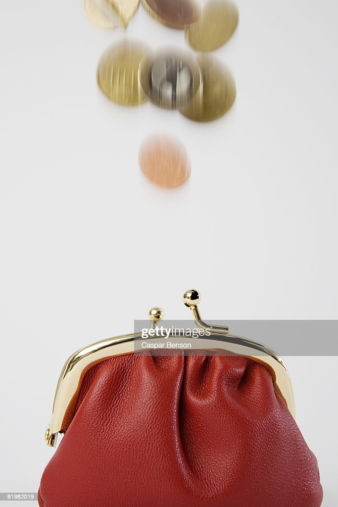 Coins falling into a purse