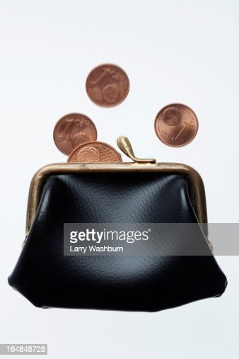 Coins falling into purse