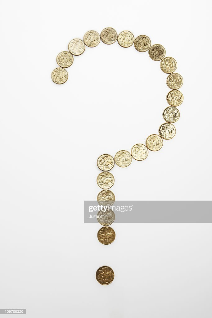 Coins forming a question mark : Stock Photo