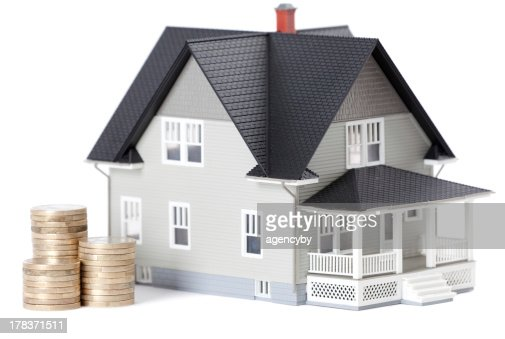 Coins in front of home architectural model : Stock Photo