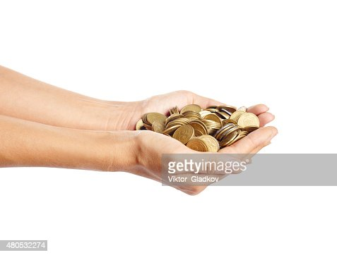 Coins in the hands : Stock Photo