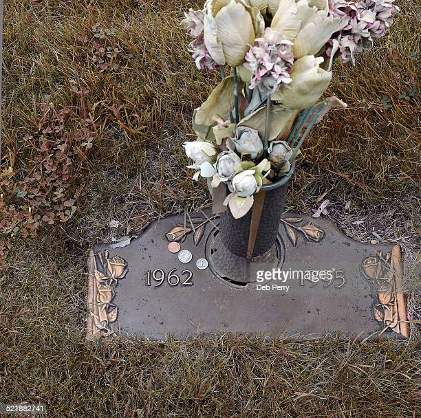 Coins on a grave marker