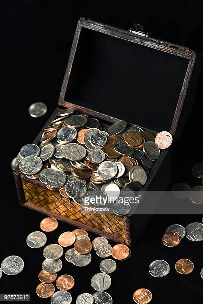 Coins overflowing box