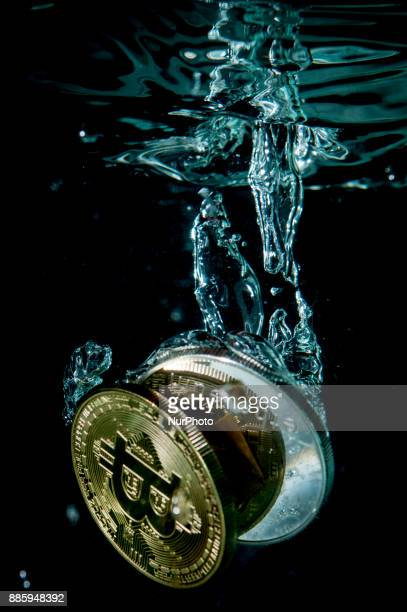 Coins representing popular cryptocurrencies are seen in this photo illustration on December 4 2017