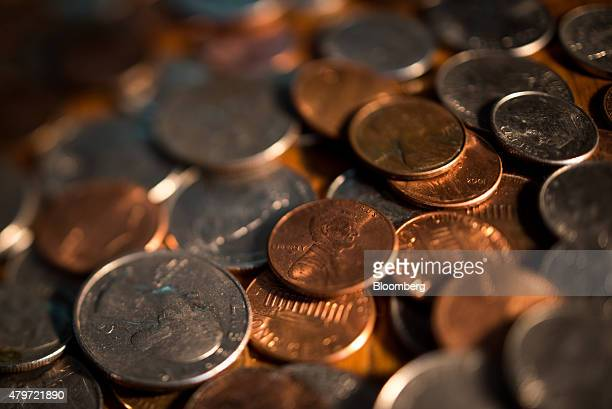 Coins sits in a pile for this arranged photograph to illustrate the theme of risk in Oradell New Jersey US on Thursday June 18 2015 Photographer Ron...