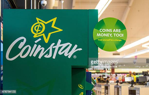 Coinstar kiosks in a large supermarket The typical Coinstar coin cashing kiosk is green and the size of a large vending machine They are located at...