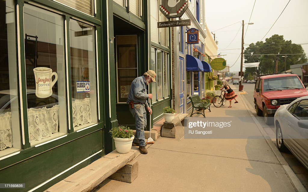 Buck Sneed, cleans up outside his wife's cafe, Cafe Ole in Creede, June 26, 2013. The cafe closed early because of a lack of customers due to a wildfires keeping summer tourist away.