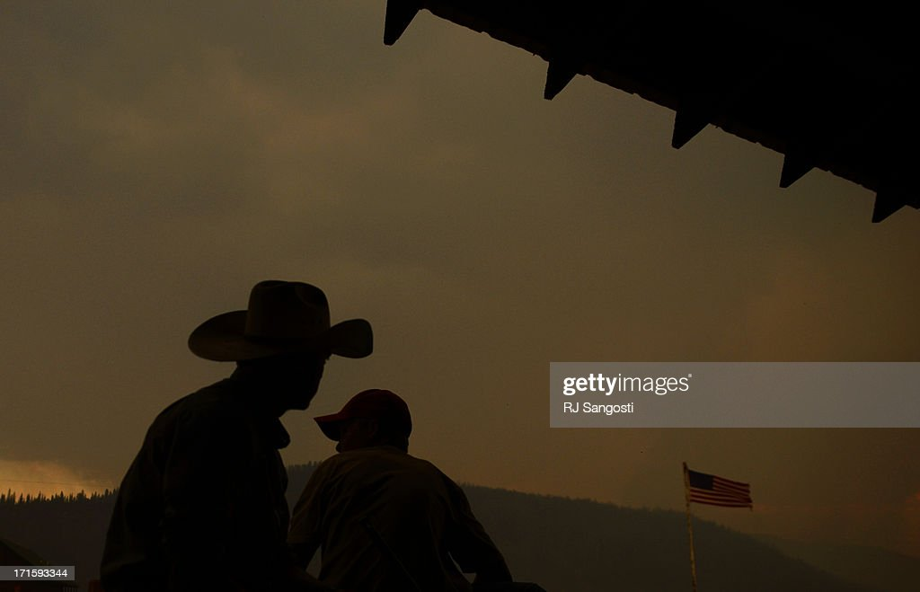 Chris Cage, left, and Dalton Davidson watch the smoke come from the Papoose Fire, June 26, 2013. The wildfire in southwestern Colorado continues to have potential for growth.
