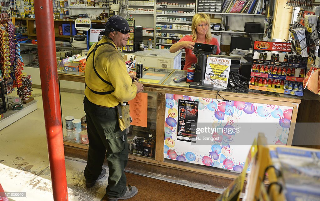 Firefighter Michael Remero was all smiles after finding out his snakes and drink were free at Gifts and Gas in Creede June 27 2013 Vicki Vinyard...
