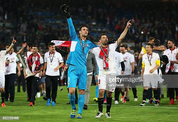 Coke and Sergio Rico of Sevilla celebrate after the UEFA Europa League Final match between Liverpool and Sevilla at St JakobPark on May 18 2016 in...