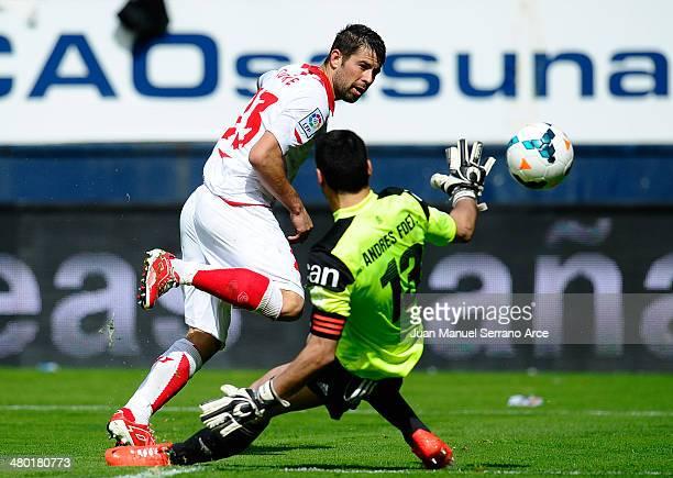 Coke Andujar of Sevilla FC duels for the ball with Andres Fernandez of CA Osasuna during the La Liga match between CA Osasuna and Sevilla FC at...