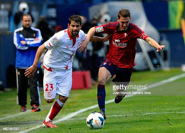 Coke Andujar of Sevilla FC duels for the ball with Roberto Torres of CA Osasuna during the La Liga match between CA Osasuna and Sevilla FC at Estadio...