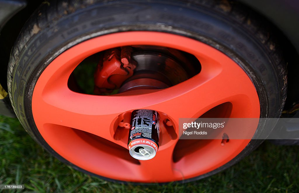 Coke cans are used in the centre of the wheels of a VW Golf during the In Praise Of All Things VW At The Annual Festiva at Harewood Housel on August 18, 2013 in Leeds, Yorkshire. The annual VW festival in its 9th year attracts around 15,000 people over the weekend, ending with the winners car parade on Sunday.
