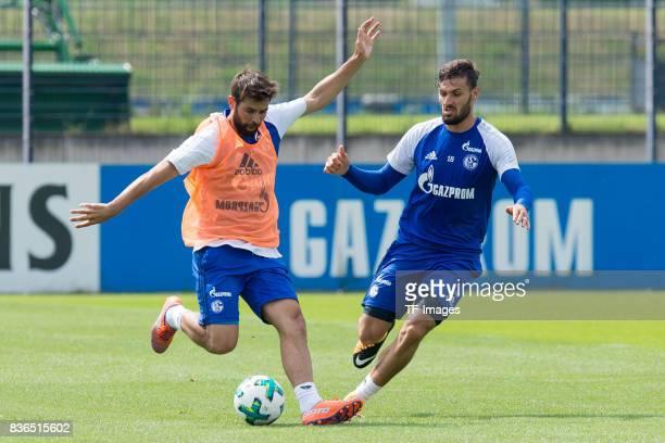 Coke of Schalke and Daniel Caligiuri of Schalke battle for the ball during a training session at the FC Schalke 04 Training center on July 5 2017 in...
