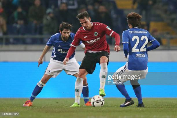 Coke of Schalke and Edgar Prib of Hannover and Atsuto Uchida of Schalke battle for the ball during the friendly match between Hannover 96 an FC...