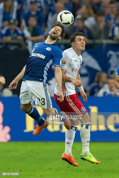 Coke of Schalke and Filip Kostic of Hamburg battle for the ball during to the Bundesliga match between FC Schalke 04 and Hamburger SV at VeltinsArena...