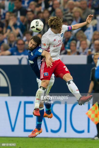 Coke of Schalke and Gotoku Sakai of Hamburg battle for the ball during to the Bundesliga match between FC Schalke 04 and Hamburger SV at VeltinsArena...