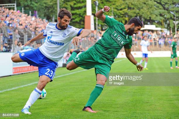 Coke of Schalke and Orkun Tosun of Guetersloh battle for the ball during the preseason friendly match between FC Gütersloh and FC Schalke 04 on...