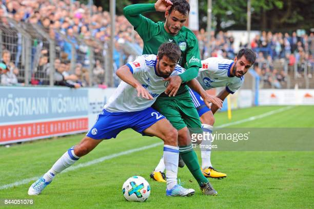 Coke of Schalke and Zakaria Azrioual of Guetersloh and Pablo Insua of Schalke battle for the ball during the preseason friendly match between FC...
