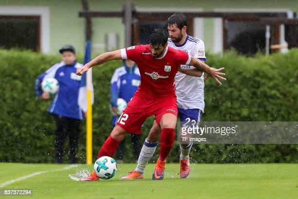 Coke of Schalke battle for the ball during the preseason friendly match between FC Schalke 04 and Neftchi Baku on July 26 2017 in Neunkirchen Austria