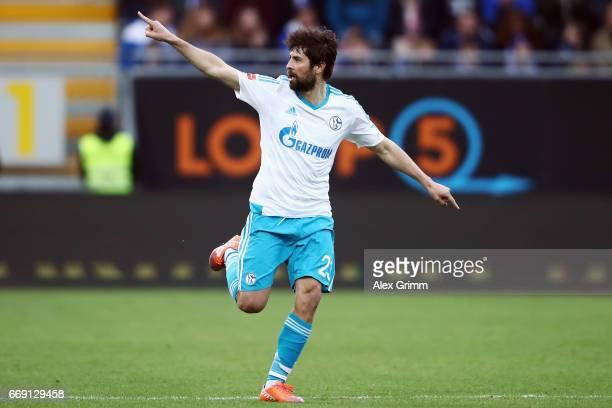 Coke of Schalke celebrates his team's first goal during the Bundesliga match between SV Darmstadt 98 and FC Schalke 04 at Stadion am Boellenfalltor...