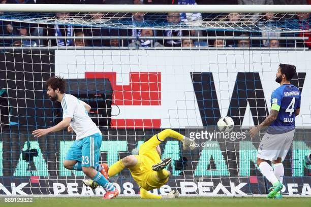 Coke of Schalke celebrates scoring his team's first goal against goalkeeper Michael Esser and Aytac Sulu of Darmstadt during the Bundesliga match...