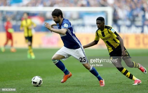 Coke of Schalke is challenged by Ousmane Dembele of Dortmund during the Bundesliga match between FC Schalke 04 and Borussia Dortmund at VeltinsArena...