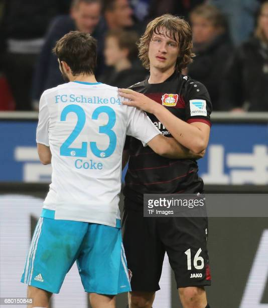 Coke of Schalke shakes hands with Tin Jedvaj of Leverkusen during to the Bundesliga match between Bayer 04 Leverkusen and FC Schalke 04 at BayArena...