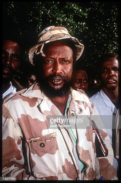 'Col' Ahmed Omar Jess poses for a photograph with his Somali rebels June 15 1992 in Kismayo Somalia Jess and his rebels move freely inside the...