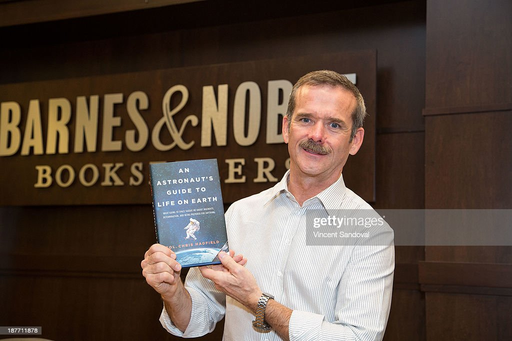 Col. <a gi-track='captionPersonalityLinkClicked' href=/galleries/search?phrase=Chris+Hadfield&family=editorial&specificpeople=2700911 ng-click='$event.stopPropagation()'>Chris Hadfield</a> signs copies of his new book 'An Astronaut's Guide To Life On Earth' at Barnes & Noble bookstore at The Grove on November 11, 2013 in Los Angeles, California.