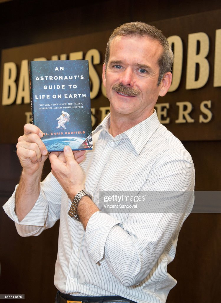 Col. Chris Hadfield signs copies of his new book 'An Astronaut's Guide To Life On Earth' at Barnes & Noble bookstore at The Grove on November 11, 2013 in Los Angeles, California.